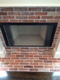 Wood burning fireplace with thin brick face and hearth