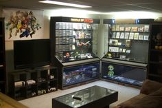 I want a game room like this, where we can hook up all of our systems and display our video game collection (toys, figures, etc)