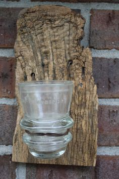 Barn Wood Recycled Candle Sconces with a Clear Vintage Insulator. $15.00, via Etsy.