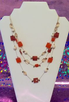 A personal favorite from my Etsy shop https://www.etsy.com/listing/294763801/necklace-multi-strand-orange-color-tones