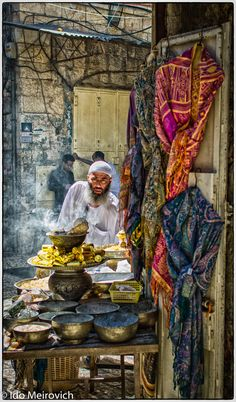 In the Muslim quarter of the Old City of Jerusalem, stands a man at a stall with different flavors of Tobacco, mainly for Hookah users.