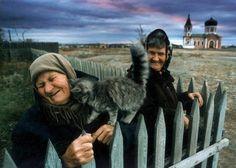A kitten loves on an old woman in the Cossack village of Velikopetrovskaya near Cheliyabinsk.