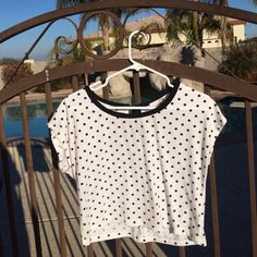 Black and white polka dot top! Size medium with a bow in the back around the neck. Forever 21 Tops