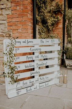 DIY White Painted Palette Order of The Day Sign Wedding Decor Millbridge Court Surrey Wedding with DIY Decor Foliage Giant Balloons Nataly J Photography Wedding Day Schedule, Wedding Day Timeline, Wedding Planning, Wedding Checklists, Pallet Wedding, Wedding Signage, Rustic Wedding Signs, Pallet Ideas For Weddings, Wedding Ideas Using Pallets
