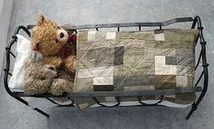 Old Metal Doll bed with Teddy Bears and a lovely old Quilt.
