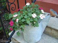 Planting flowers in unusual containers.