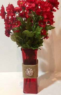 Red glass vase rope wrapped with red and white seashell Beach