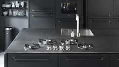 A kitchen island from Alpes Inox features a five-burner gas cooktop, a sink, and drawers. Read more about it and more modular kitchen pieces...