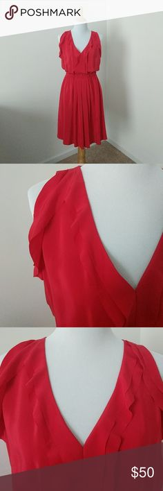 """🎉HP 2/1 🎉Loft Silk Dress PETITE NWOT Loft red silk petite dress. This 100% silk red dress from Loft features ruffle detail at front and side the sleeve and soft pleats down the front. Cinched waist with elasti. Never worn - I decided last minute to not wear it for a photo shoot with my husband, and it no longer fits me. Tag was taken off, but never worn. Length from waist down is approx 22"""". LOFT Dresses Midi"""