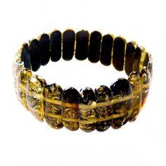 Bracelet en ambre vert véritable, ce bracelet élastique s'adaptera à tous les poignets et peut être porter tous les jours. Largeur comprise entre 2 et 2,5 cm. Circonférence: 17 cm Poids approximatif :14.5 grammes