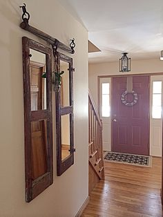 Front Entry with chippy old window mirrors and horse yoke.
