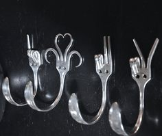 Collector set 4 Silverware Coat Hooks ... I'd like to try this with some old silverware I have.