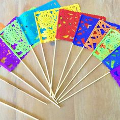 """These Mexican Papel Picado flags are handmade! They come in a set of 12 flags. Great addition to your next Fiesta decor, use them as centerpieces to add a splash of color to your table. - 12"""" tall flags. Assorted colors - Ships in 1-3 business days. - Made in Mexico."""