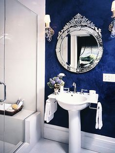 The royal blue and this ornate mirror are a nice pair in this Ammie Kim design. #hgtv #bathroom #mirror