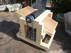 Thickness Sander by Vagabond55 -- Homemade thickness sander constructed from 2x4s, MDF, particle board, bearings, shafting, pulleys, and an electric motor. http://www.homemadetools.net/homemade-thickness-sander-17