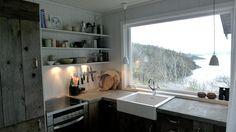 Scandinavian cabin kitchen, concrete counters, wood cabinets, open shelves, wood painted walls