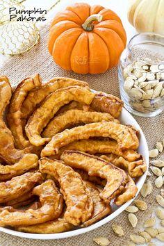 Golden Pumpkin Pakoras coated with chickpea flour, garam masala, chili powder, ground turmeric, and cumin seeds. They are crispy crunchy and gluten free.   RotiNRice.com