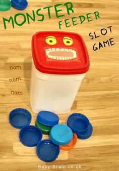 Monster Feeder slot game - fine motor skill development - fun DIY baby/toddler activity, from http://baby-brain.co.uk