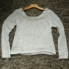 Free People Sweater This is a light grey free people sweater.  It has a wide scoop neck, and is very sexy hanging off one shoulder, if that's how you choose to wear it.  ;)  only worn twice ! Free People Sweaters