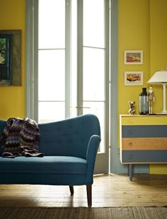 Yellow, grey and petrol blue living room colour scheme