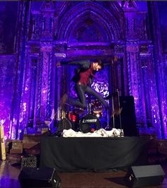 """So apparently on the set of """"Jessica Jones,"""" one of the crew members caught this awesome shot of David Tennant rocking it out on the stage with an air guitar.  This wins."""