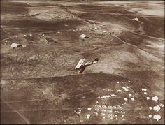 A Plane Descending to the Hangars of the 1st Australian Flying Corps by Frank Hurley
