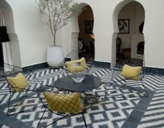 love this space! outdoor modern morroccan living room! cool furniture! amazing grey and white tile!