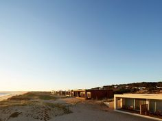 Want to book a room with a view? Start at one of the 11 unique stand-alone bungalows at Bahia Vik—with 2 or 3 bedrooms each & filled with site-specific art—or one of 10 suites in the central building. With views of the sand dunes of Uruguay's eastern coast, the resort offers a library, a games room (with ping pong), a spa, and gym, all thanks to art-collecting & wine-making power couple Alex and Carrie Vik. Sister property, Playa, directly next door was designed by Uruguayan architect