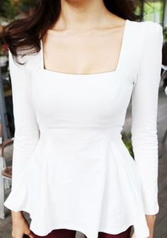 Front view of model in white long sleeve peplum top