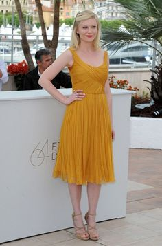 """Kirsten Dunst - Cannes 2011 - """"Melancholia"""" Photocall (unusual mustard colour, but I like it on her)"""