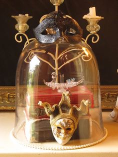 Tassels Twigs and Tastebuds: Oh my cloche...a masquerade!    Love the small Venetian mask, would like 2 or 3 in a cloche~