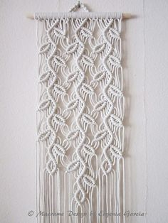 """Macrame wall hanging - Sprigs #1 - trendy and stylish wall decor for your home or office. Handmade, original idea and design by Evgenia Garcia. Color: ivory Sizes: Dowel length – 12 (30.5 cm) Panel height from top of dowel to longest end – 54.5"""" (138.5 cm) Cord d = 1/8 (3.2 mm} NOTE: 1."""