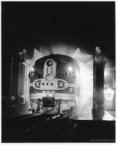 The washrack at Santa Fe's shop in Argentine, Kans., gives an diesel a fresh look. Union Station, Train Station, Freight Transport, Bnsf Railway, Train Posters, Railroad Pictures, Old Trains, Steam Engine, Train Tracks