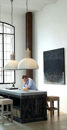 island - dark charcoal-y wood; concrete looking counter; white tile; industrial lights - looks inexpensive to achieve for industrial look