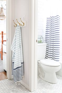 Blue And White Striped Turkish Towels Shower Curtain Give This Bathroom A Slight Nautical Feel