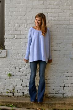 Simple light blue top with flares.  Perfect with a simple necklace or scarf but also great for layering all winter long. -Studio 3:19