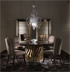 Soft pleated suede and elegant glasswork complete this contemporary luxury style using the B-52 Round Dining Table, Sharpei 2 Chair and Selfie Wall Vetrines from the Roberto Cavalli Home Interior's Iconic Collection stocked by Kings of Chelsea kofc.co.uk