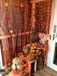 Our new window display for autumn 2015 with willow branches, autumn leaves, squirrels, foxes, owls and pumpkins made from hessian and pinecones, flower shop display, florist shop display, autumn flowers, fall flowers, flower shop, florist shop, florist, unforgettable flowers cork, florist cork