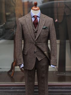 This Donegal tweed three-piece suit is brown with a subtle flecks of earthy colours. Woven by Molloy & Sons, Donegal and tailored by Bladen. All the garments can favourably be worn as separates.