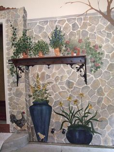 Shelf on a stone faux finished wall