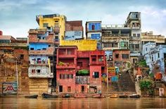 I love the colors of india. This photograph was taken near Varanasi from the ganges river. Varanasi is a very dark and dusty place but if you look closer, crazy colors come your way. #architecture #house #building #urban #indian #varanasi #holi