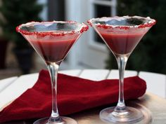 Red Velvet Cake Martini:  Whipped cream cheese frosting (from 12-oz container)   red colored sugar   2 teaspoons chocolate-flavor syrup   Crushed ice   1/4 cup cake-flavored vodka   1/4 cup crème de cacao   6 tablespoons buttermilk   1 to 2 drops red food color