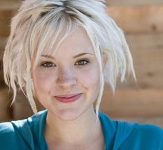 Brea Grant. Having some dreadlocks in short blonde hair.