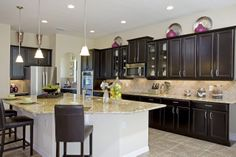 Classic espresso cabinets with light granite Standard Pacific Homes, Espresso Cabinets, Light Granite, Parade Of Homes, New Homes For Sale, Kitchen Cabinets, Kitchen Counters, Kitchen Decor, Kitchen Ideas
