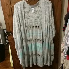 Charlotte Russe sweater/poncho/wrap/cardigan Gray and mint green. Long, hits at mid-thigh (I'm 5'5) and super soft! Has sleeves and pretty detailing. Size xl, but would fit medium to size 3x - super versatile!  I wore it once with a mint green tee underneath. Charlotte Russe Sweaters Shrugs & Ponchos