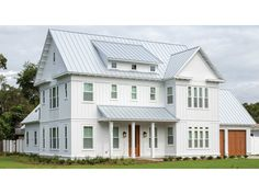 This impressive country farmhouse plan is well designed and can accommodate any size family. In addition to a fantastic open plan layout, there is a more intimate parlor area and a first floor master suite with a large walk-in closet/dressing area.  The r