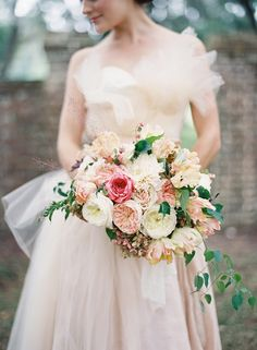 Seriously romantic bridal bouquet in pink, peach, and ivory with hanging greens