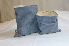 Waxed Cotton Denim snack bags and lunch bags, and sandwich bags. We carry many different fabrics and also have waxed canvas bags, snack bags, and beeswax wraps. Rainbow Bee Design - All Natural Beeswax Fabrics