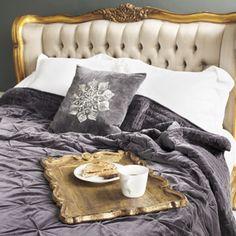 Gilt framed, tufted bed. Would be lovely in a dark blue or black bedroom