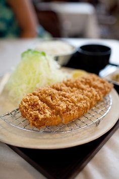 Maisen katsu. You will see a different world. Cruncy outside, soft/juicy pork inside. Used to take foodie American,Goldman global head to here. That good... super casual. They are open for lunch as well.